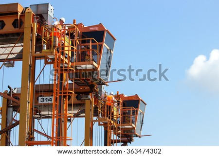 ROTTERDAM, NETHERLANDS - SEPTEMBER 8, 2013: Straddle carriers used for moving around containers in the Port of Rotterdam.  - stock photo