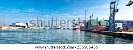 ROTTERDAM - OCTOBER 4, 2014: Container terminal in rotterdam harbor. It is the largest port in Europe, covering 105 square kilometers (41 sq miles) - stock photo