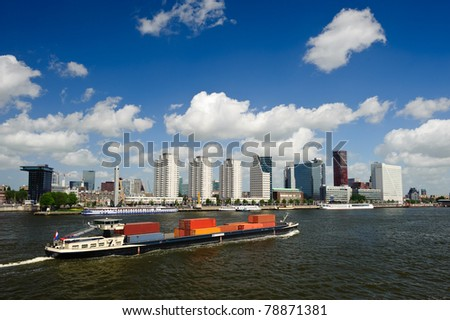Rotterdam skyline and a container ship on the meuse river the Netherlands, Europe - stock photo