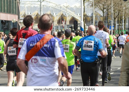 ROTTERDAM, THE NETHERLANDS APRIL 12, 2015: Athletes running past in the 35th NN Rotterdam Marathon held in the city center. The marathon is well known for its fast times. - stock photo