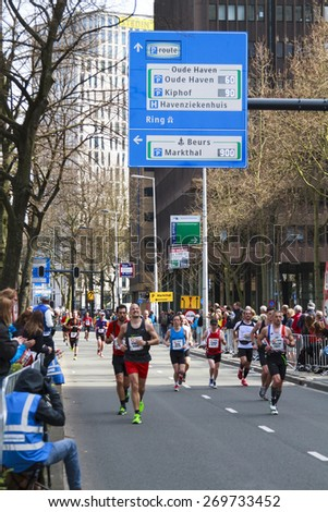 ROTTERDAM, THE NETHERLANDS  APRIL 12, 2015: Runners on the streets competing in the 35th NN Rotterdam Marathon held in the city center. The marathon is well known for its fast times. - stock photo