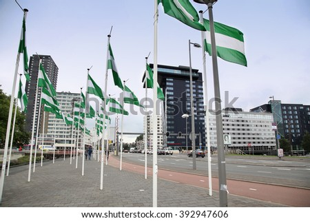 ROTTERDAM, THE NETHERLANDS - 18 AUGUST: Rotterdam is a city modern architecture, Nieuwe Leuvebrug street with green-white-green flags of Rotterdam in Rotterdam, Netherlands on August 18,2015. - stock photo