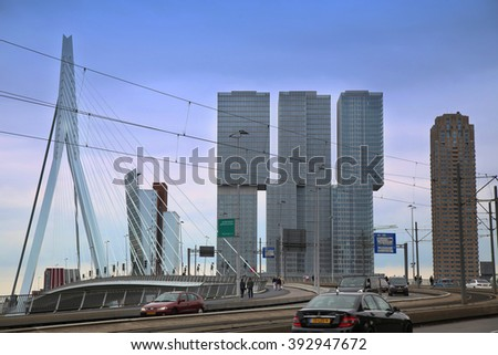 ROTTERDAM, THE NETHERLANDS - 18 AUGUST: Rotterdam is a city modern architecture, view on Erasmus Bridge and skyline of Rotterdam, river Maas in Rotterdam, Netherlands on August 18,2015. - stock photo