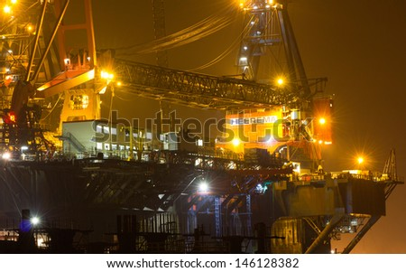 ROTTERDAM, THE NETHERLANDS � 11 FEBRUARY 2012: Cranes on top of the �Balder�, a deepwater construction vessel, 154m long and able to lift up to 6,300t in Rotterdam, on February 11, 2012