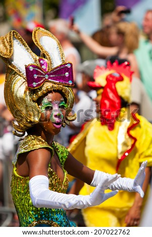 ROTTERDAM, THE NETHERLANDS - JULY 19, 2014, Carnival dancer at the Caribbean Carnival street parade on July 19 in Rotterdam, The Netherlands  - stock photo