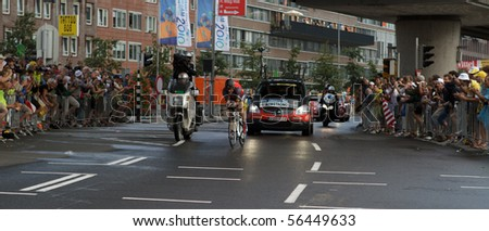 ROTTERDAM, THE NETHERLANDS - JULY 3: Lance Armstrong on his way to a fourth position in the 2010 Tour de France prologue time trial. July 3, 2010 in Rotterdam, The Netherlands - stock photo