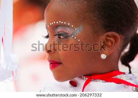 ROTTERDAM, THE NETHERLANDS - JULY 19, 2014, Young carnival dancer at the Summer Carnival street parade in Rotterdam on July 19 in Rotterdam, The Netherlands  - stock photo