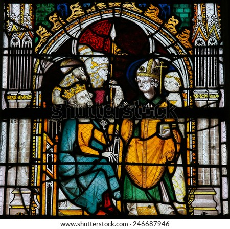 ROUEN, FRANCE - FEBRUARY 10, 2013: Stained glass window depicting a bishop and a king in the Cathedral of Rouen, France. - stock photo