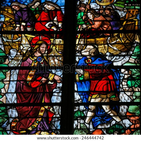 "ROUEN, FRANCE - FEBRUARY 10, 2013: Stained glass window depicting Jesus calling Simon Petrus (Saint Peter) to become a ""fisher of men""  in the Cathedral of Rouen, France. - stock photo"