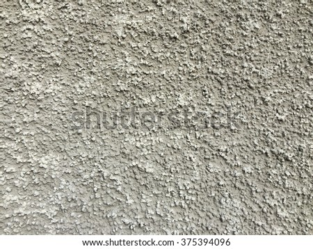 Rough beige wall texture - stock photo