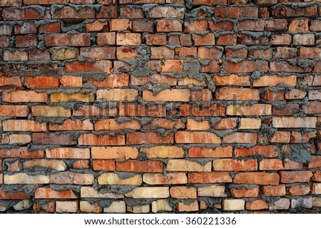 rough brick wall with ugly cement streak - stock photo