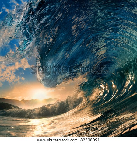 rough colored ocean wave breaking down at sunset time - stock photo