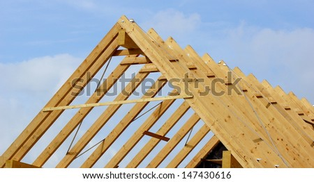 rough construction of the roof structure of the house of wood - stock photo