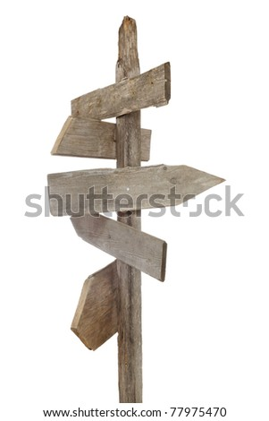 Rough hewn blank wood signs pointing in various directions