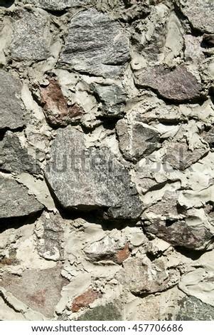 rough masonry stone wall as background - stock photo