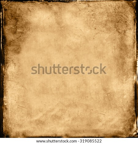 Rough old burnt background with dark edge. - stock photo