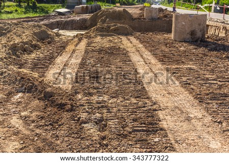 Rough road land During construction.The road is under construction - stock photo