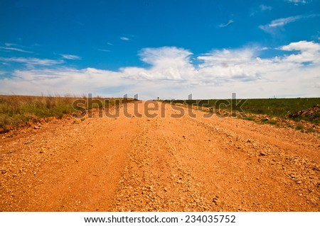 Rough road with red sand in South Africa - stock photo