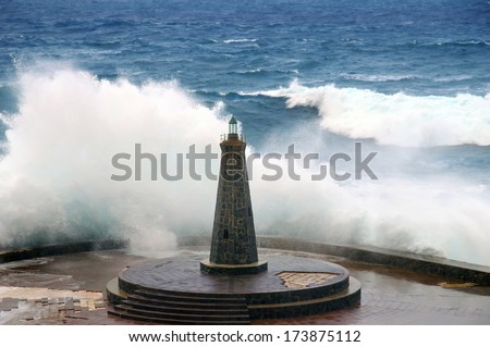 Rough seas with large waves breaking on the shore - stock photo