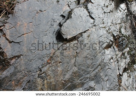 Rough shiny rock - stock photo
