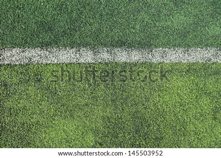 rough soccer field with white stripe background - stock photo