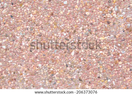 rough texture surface of exposed aggregate finish, Ground stone washed floor, made of small sand stone in light brown color - stock photo