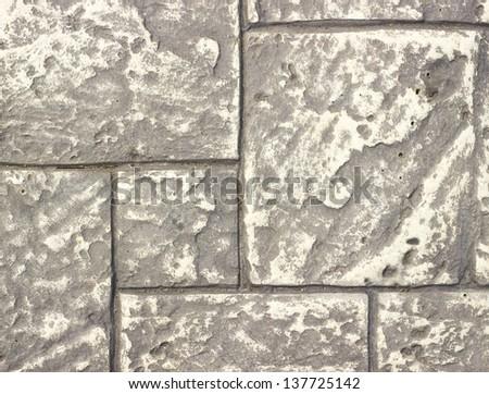 Rough textured concrete tiles walkway background - stock photo