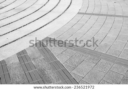 Rough textured stone tiles, exterior walkway, perspective view. Large square  patterned flooring. - stock photo
