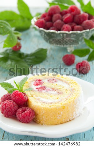 Roulade with raspberries and cream. - stock photo