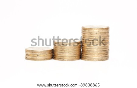 Rouleau of metallic yellow coins is isolated on a white background
