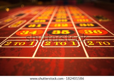Roulette table with red felt