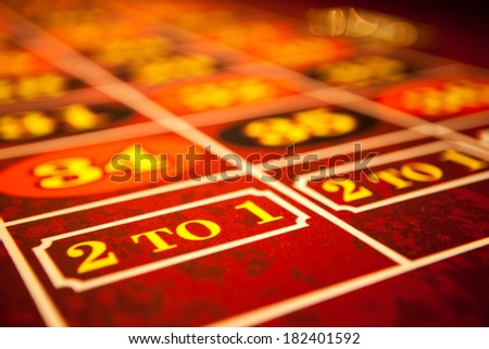 Roulette table with red felt - stock photo