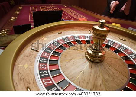 Roulette wheel and croupier hand in casino