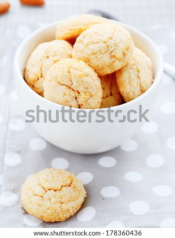 round almonds cookies in a bowl, food