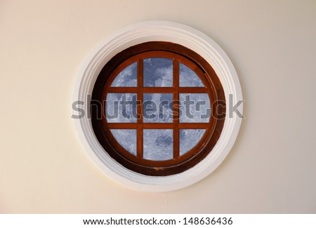 Round and vintage shape of glass window on a brick wall building digital composite with moon. Moon Globe shape courtesy of NASA - stock photo
