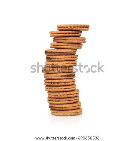 Round biscuits with chocolate filling on a white background