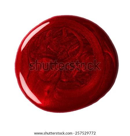 Round blot of red nail polish isolated on white background - stock photo
