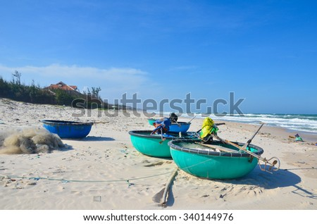 Round boats on beach - stock photo