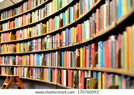 Round bookshelf in public library - stock photo