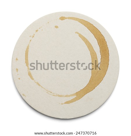 Round Cardboard Coaster With Drink Ring Stains Isolated on White Background. - stock photo