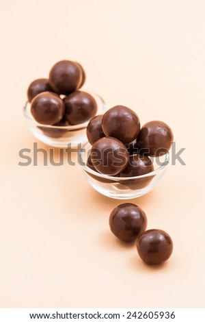 Round chocolate candy on table. - stock photo