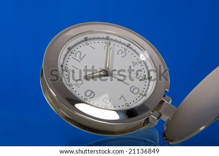 round clock showing time on blue - stock photo