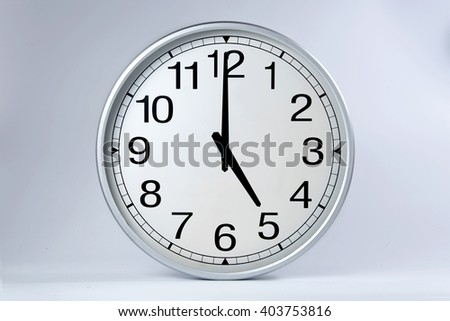 Round clock shows shows at 5 o'clock,  - stock photo