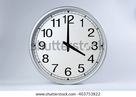 Round clock shows shows at 4 o'clock,  - stock photo