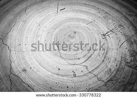 round color paint on cracked cement table in soft focusing ,black and white tone - stock photo