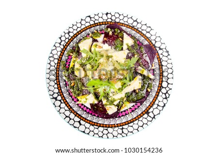 round colored plate, cheese cut Parmesan, fresh juicy greens, beet, buryak isolated on white background