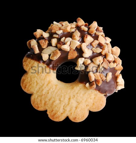 Round cookie on pure black background. Easy to use on your project - stock photo