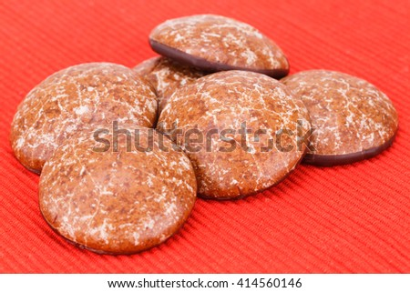 Round cookies isolated on red cloth background. - stock photo
