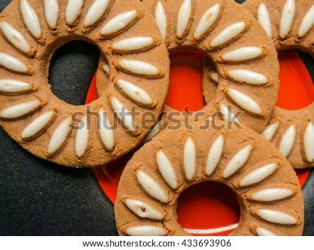 Round cookies served on a plate - stock photo