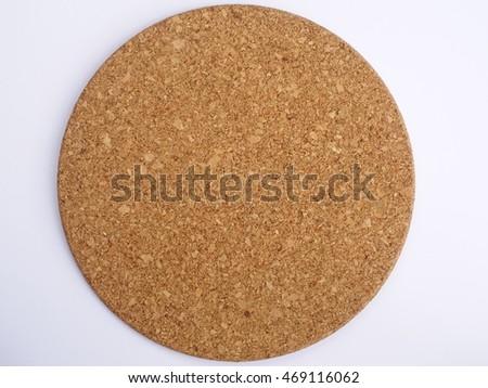 round cork board on white background